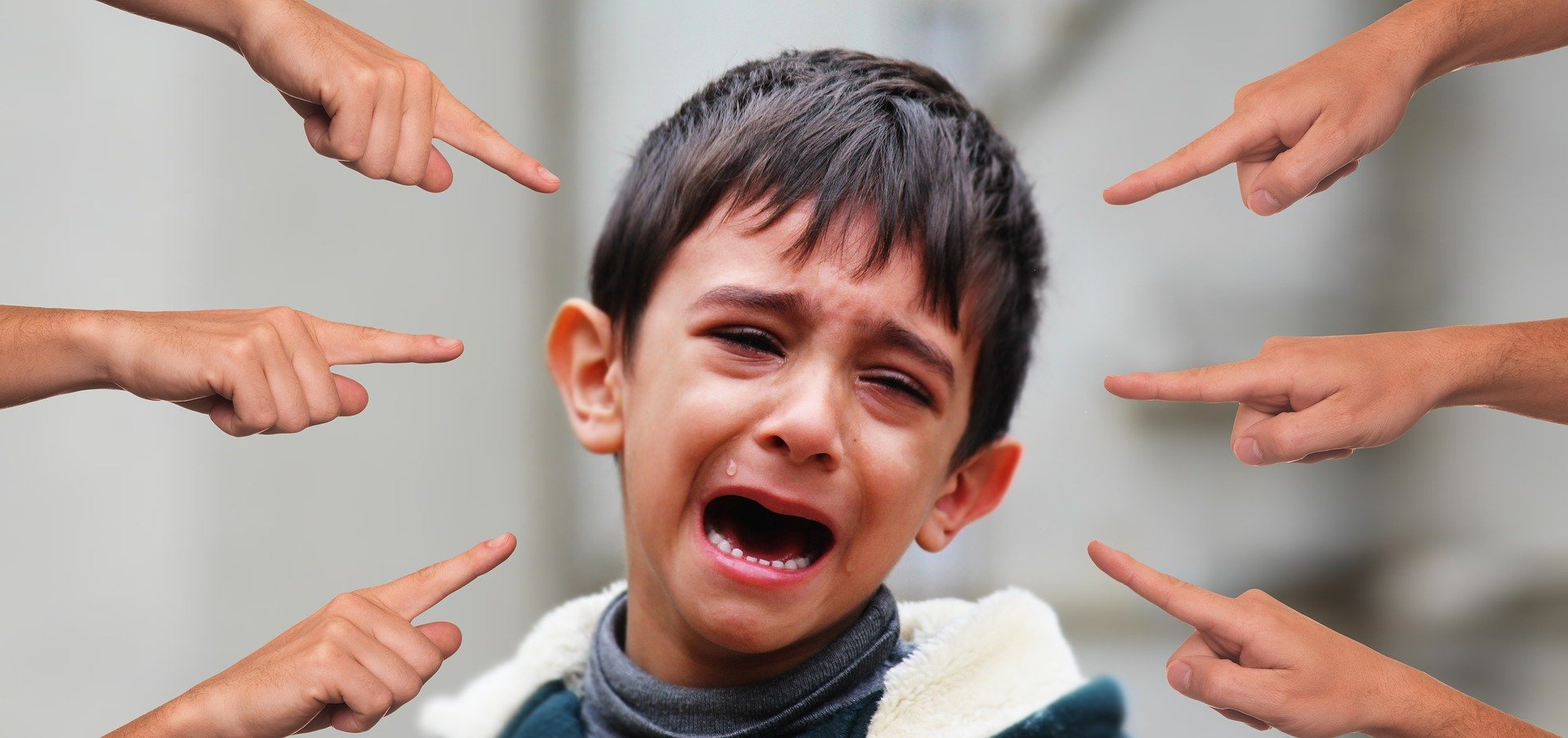 Boy in tears due to bullying